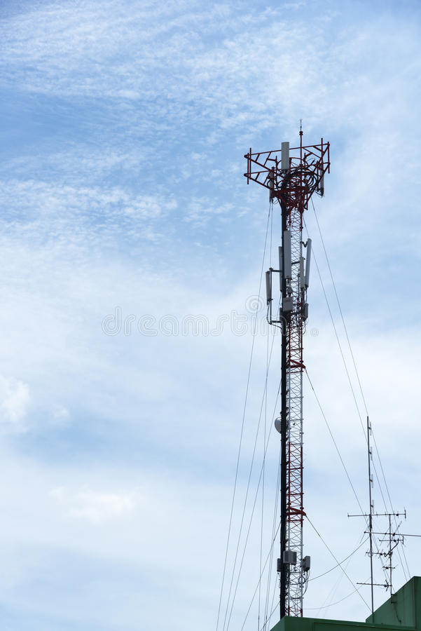 Telephone transmission pole. On the building royalty free stock images