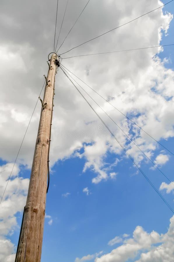 Telephone utility pole. Against a cloudy sky stock photos