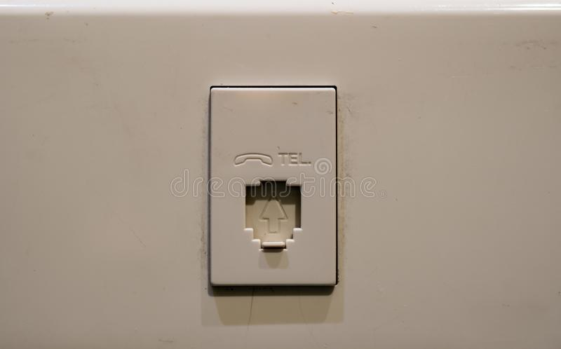 Telephone Wall Plug with bevel logo royalty free stock photo