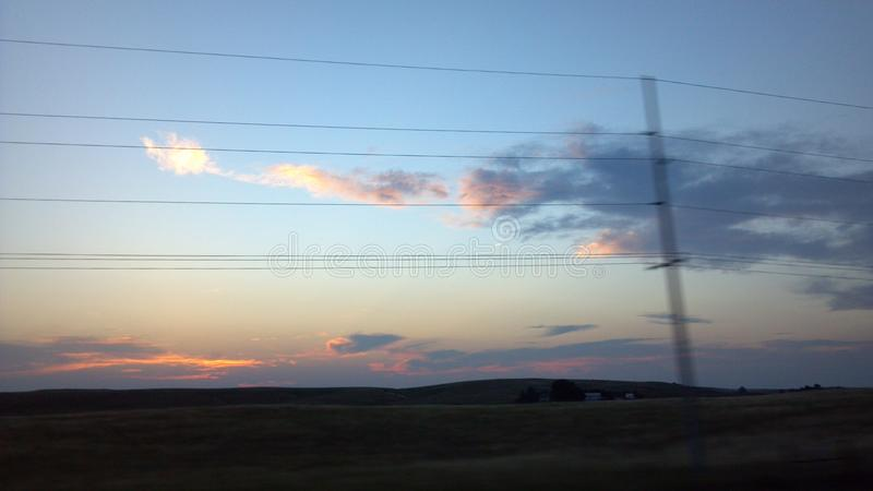 Telephone Wires in Front of Glowing Clouds royalty free stock photo