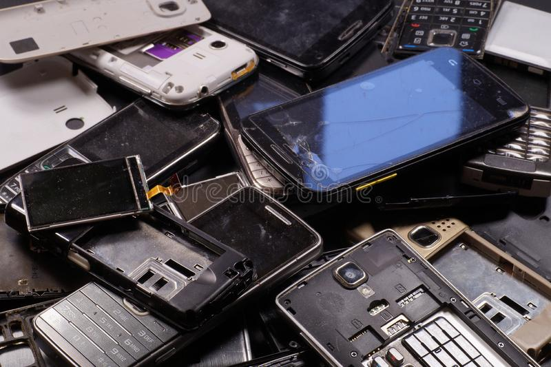 Telephones and smartphones of various types and generations not suitable for repair. Electronic scrap stock photos