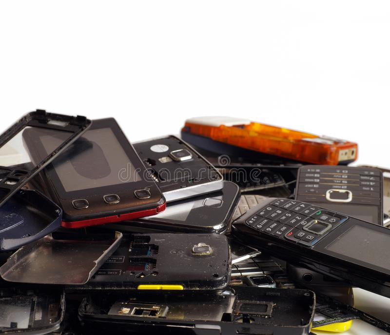 Telephones and smartphones of various types and generations not suitable for repair. Electronic scrap royalty free stock photos