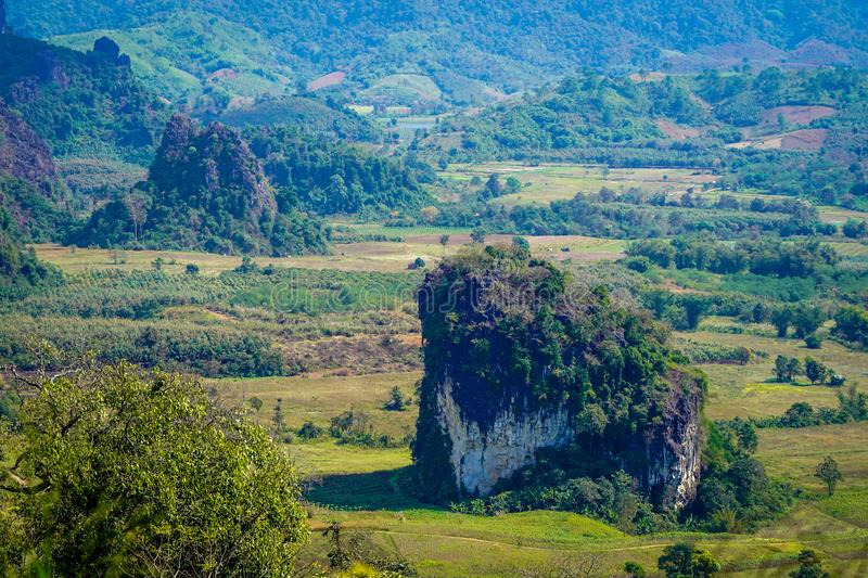 Telephoto shooting on the mini mountain. Beautiful landscape  telephoto shooting on the mini mountain on the ground around with field and forest., Phayao stock photography