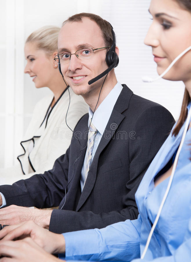 Download Telesales Or Helpdesk Team - Helpful Man With Headset Smiling At Stock Image - Image: 35121291