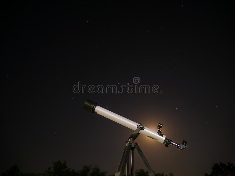 Telescope against the starry sky royalty free stock photos