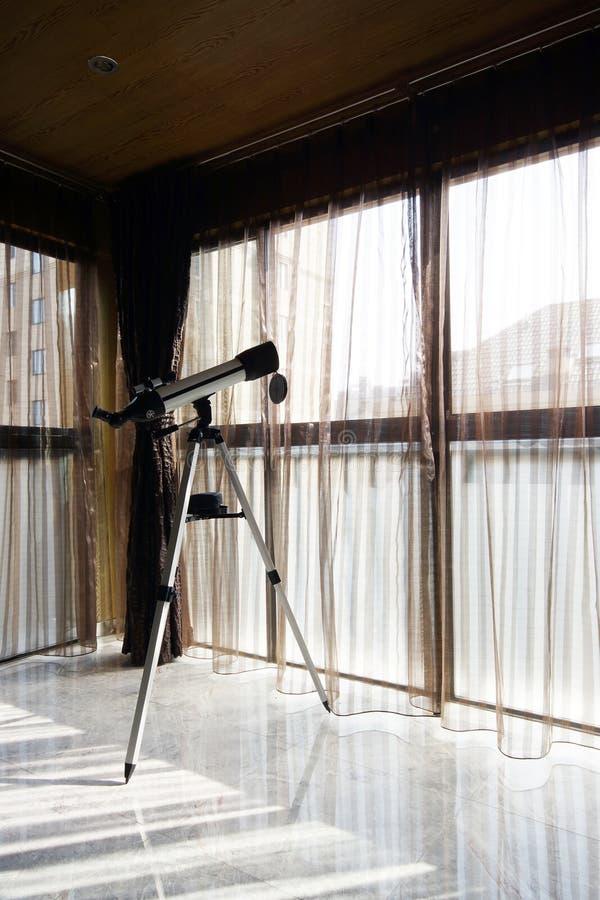 Telescope on the balcony royalty free stock photography