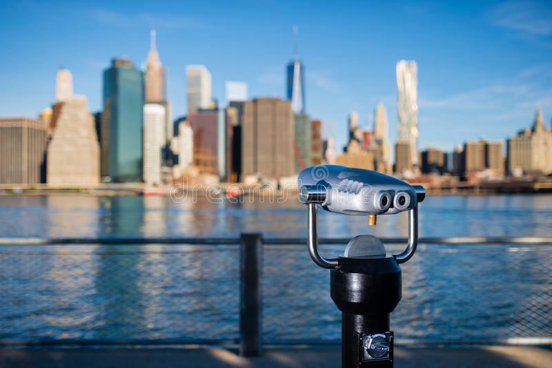 Telescope with blurred New York City silhouette royalty free stock photos