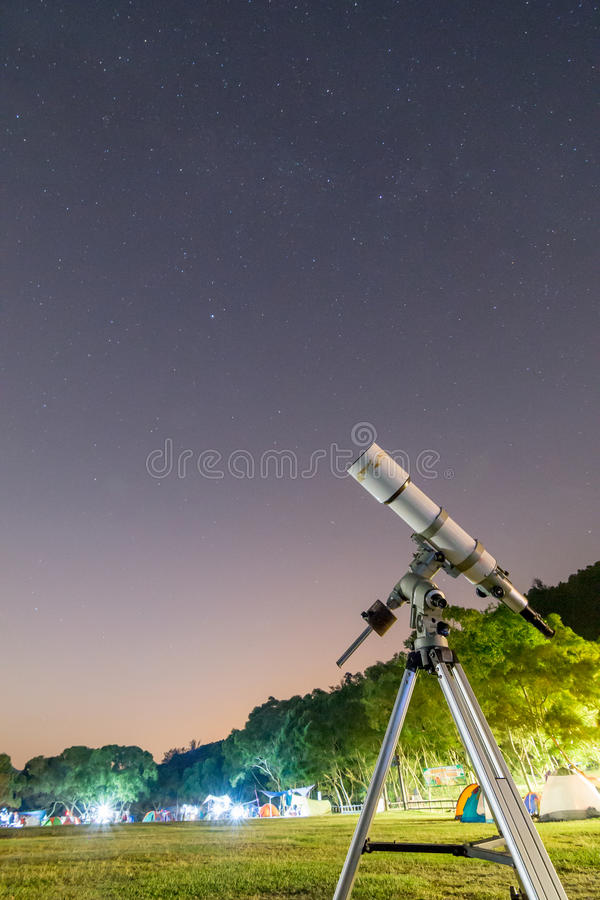 Telescope in Campsite and Starry Sky stock image