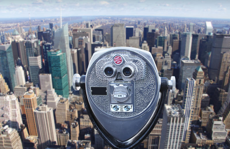 Telescope overlooking Manhattan skyline royalty free stock images