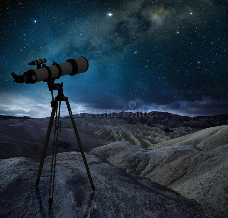Telescope pointing the milky way in a rocky desert royalty free stock photo