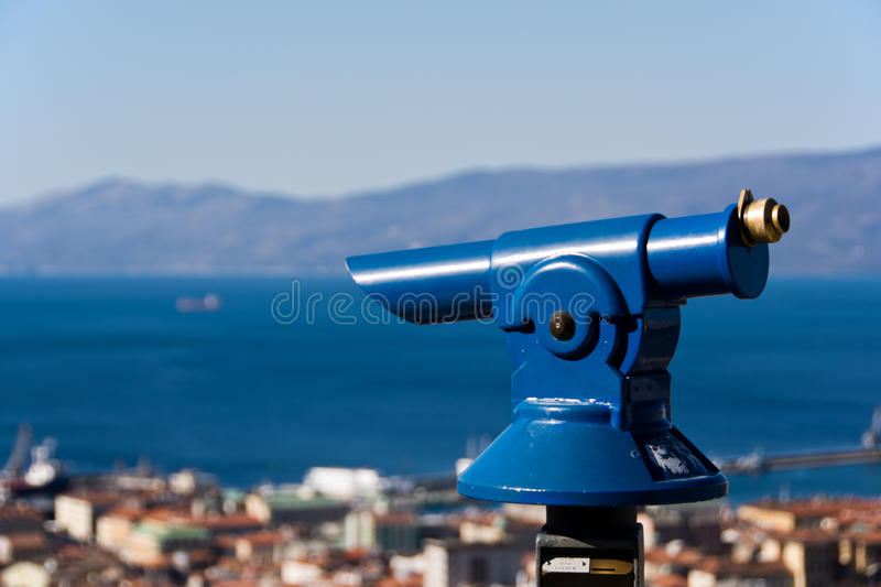 Telescope to observe panorama. Coin operated telescope to observe the coastal landscape stock image