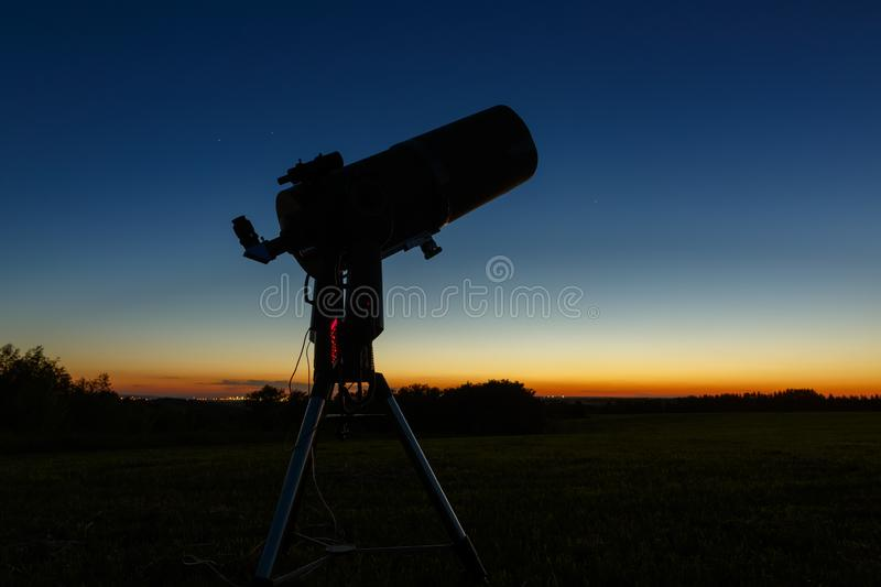 Telescope to study stars and planets is prepared for outdoor observations.  stock images
