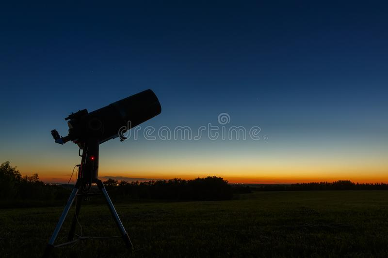 Telescope to study stars and planets is prepared for outdoor observations.  royalty free stock photography