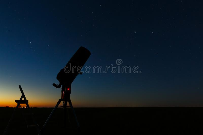 Telescope to study stars and planets is prepared for outdoor observations.  stock photo