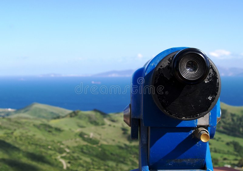 Telescope viewfinder and view. View of the African Coast from the spanish mountains and countryside with a blue telescope viewfinder stock images