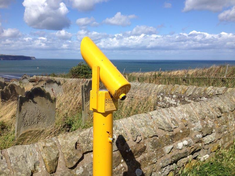 Telescope in yellow stock photography