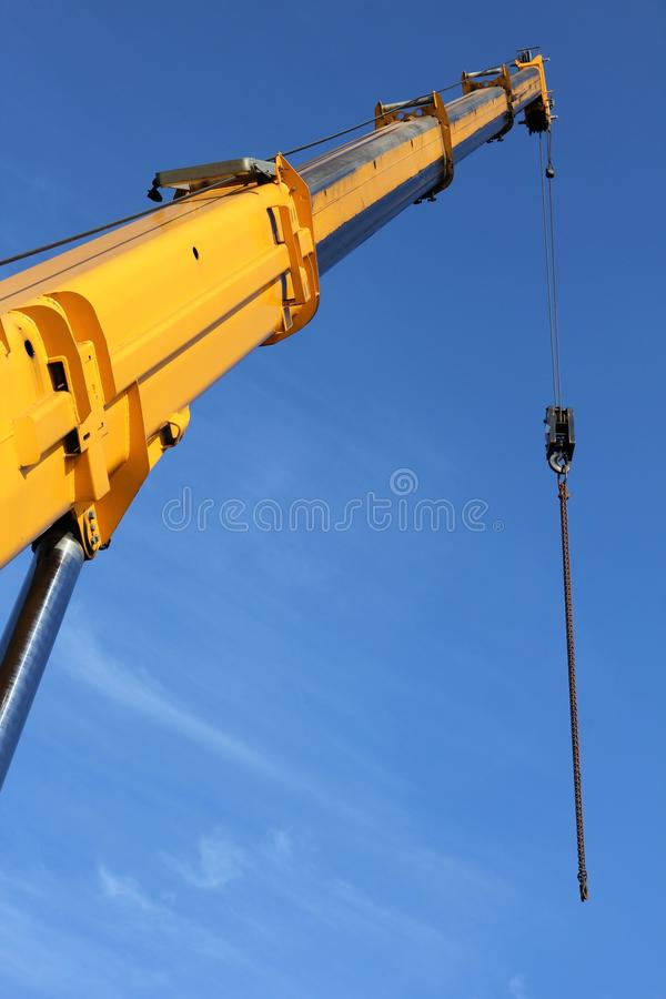 Telescopic crane. Against blue sky royalty free stock photo