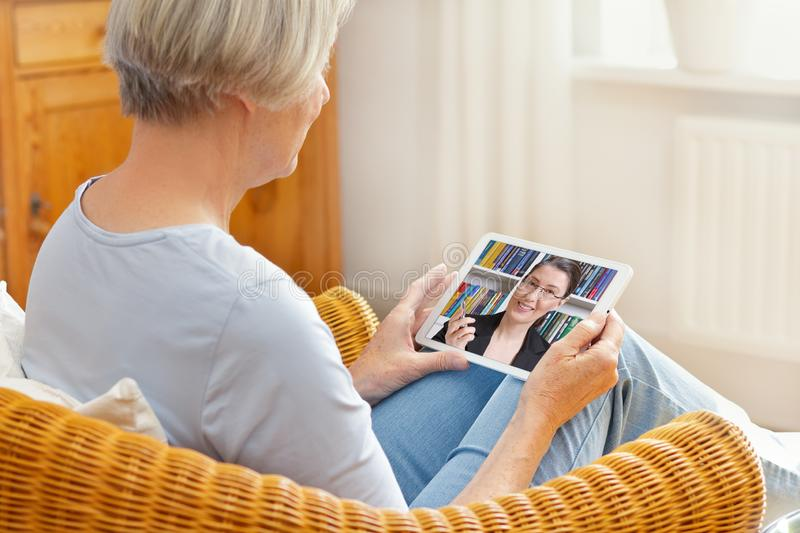 Teletherapy senior woman tablet computer royalty free stock photography