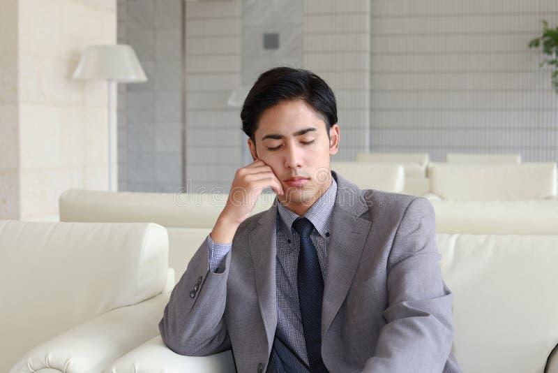 Teleurgestelde Aziatische zakenman royalty-vrije stock foto's