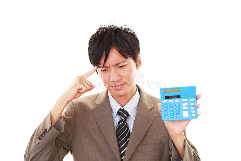 Teleurgestelde Aziatische zakenman stock foto