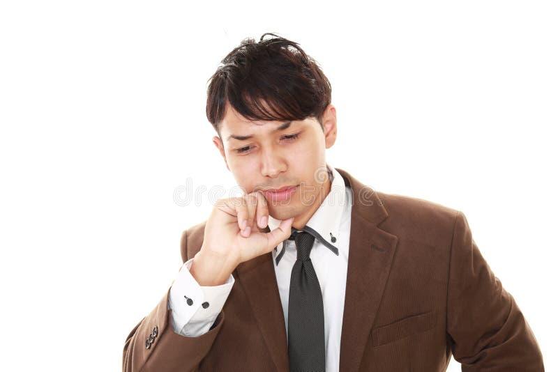 Teleurgestelde Aziatische zakenman stock fotografie