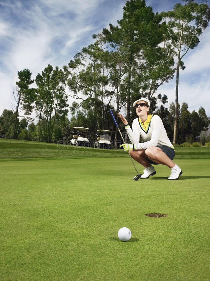 Teleurgestelde Golfspeler bij Groen Zetten royalty-vrije stock foto's