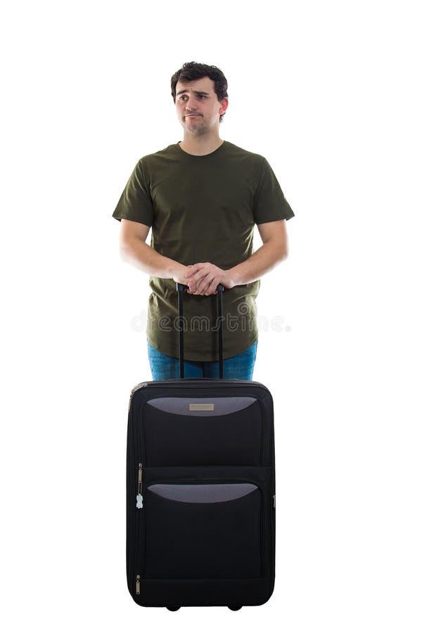 Teleurgestelde kerel met bagage royalty-vrije stock afbeeldingen