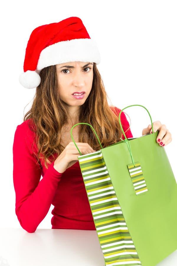 Teleurgestelde Kerstmisvrouw stock afbeelding