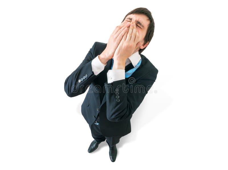Teleurstellingsconcept Ongelukkige zakenman vanaf bovenkant stock fotografie