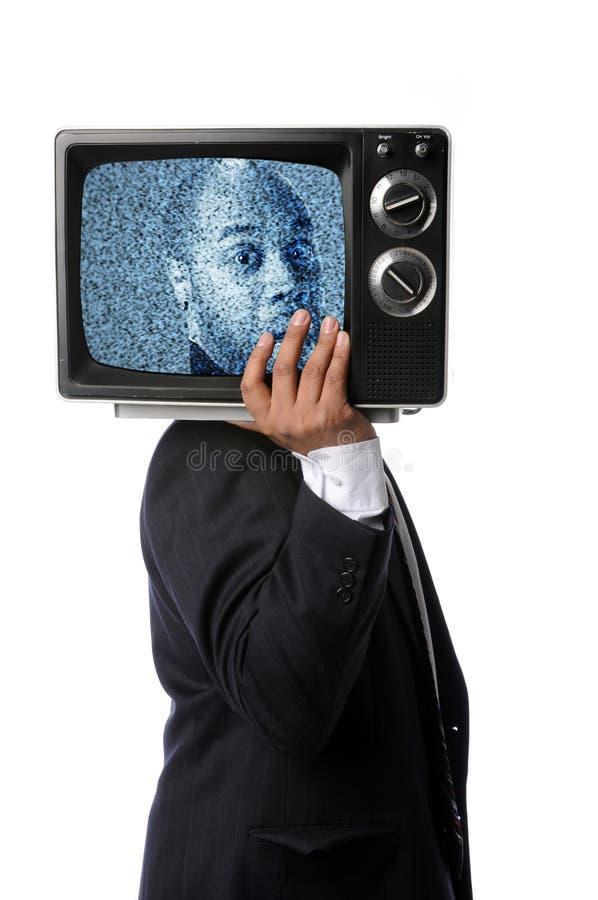 Televisão do vintage da terra arrendada do homem de negócios imagem de stock royalty free