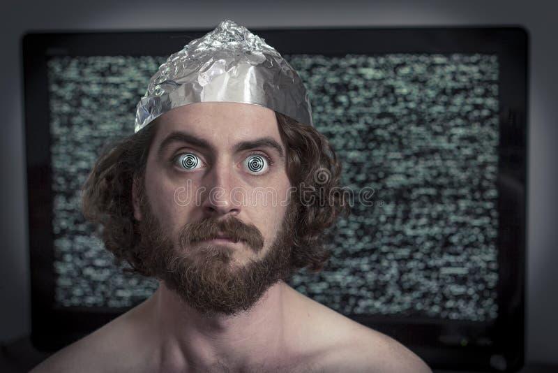 Televisão hipnotizada imagem de stock