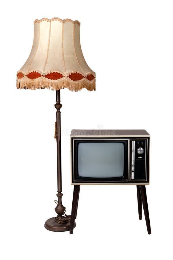 Televisión de madera y lámpara de la vendimia vieja foto de archivo