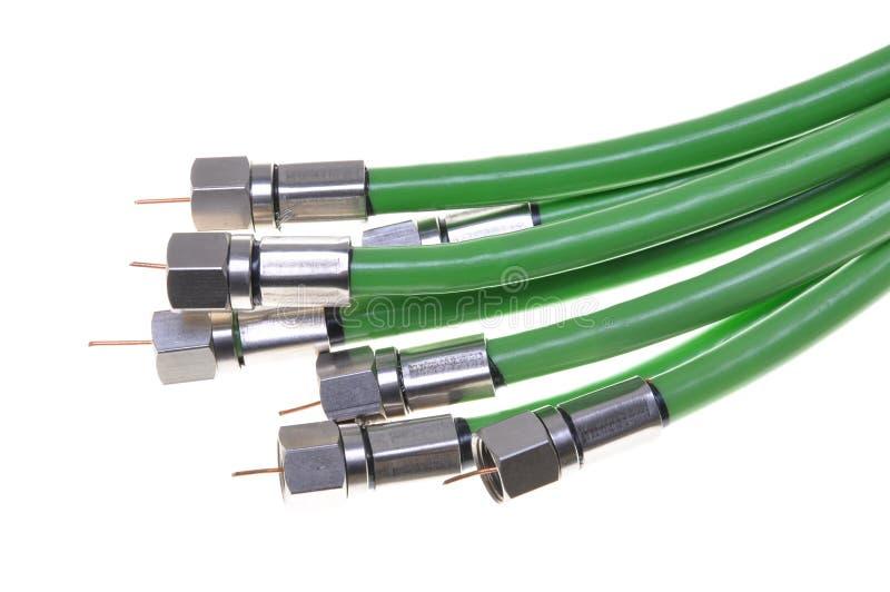 Televisión por cable coaxial verde con los conectores imagen de archivo