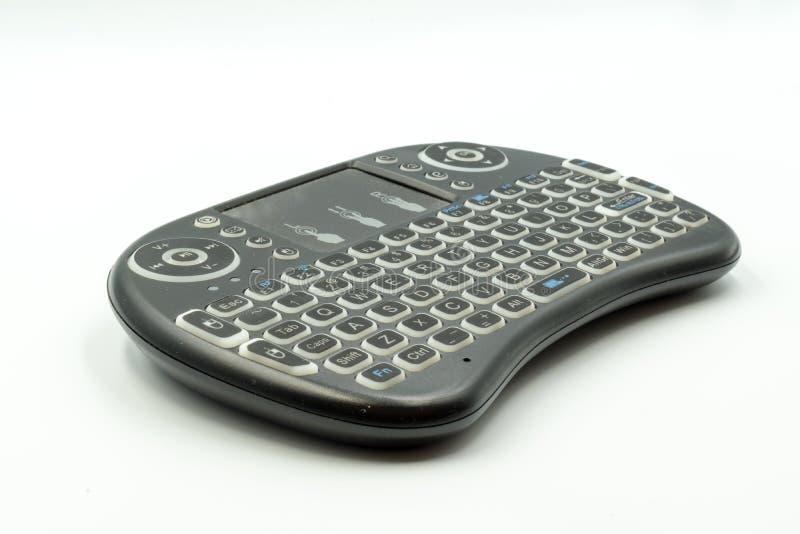 Televisie draadloos toetsenbord voor gemakkelijk bereik royalty-vrije stock afbeelding