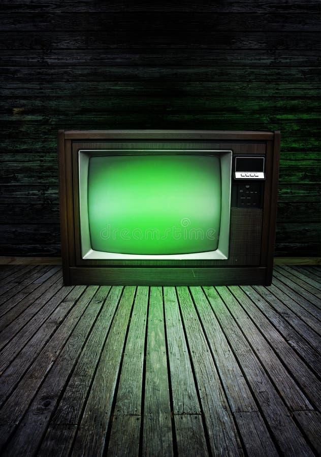 Televisie met groene gloed stock afbeelding