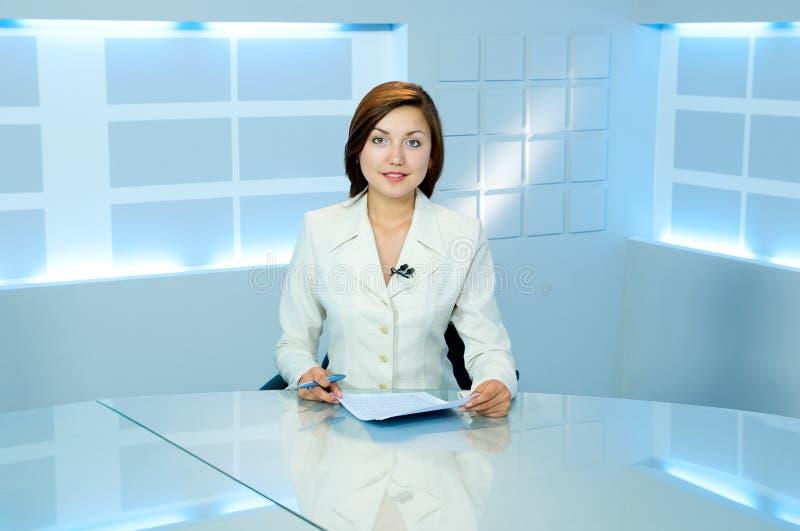 Television anchorwoman at TV studio royalty free stock images