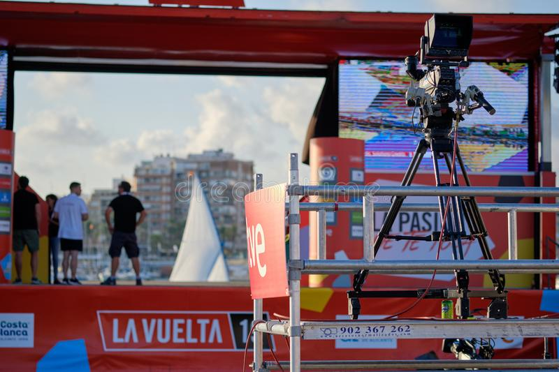 Television broadcasting La Vuelta competition international poplar sportive event shown big screen outdoors. Torrevieja, Spain - August 24, 2019: Television stock photos