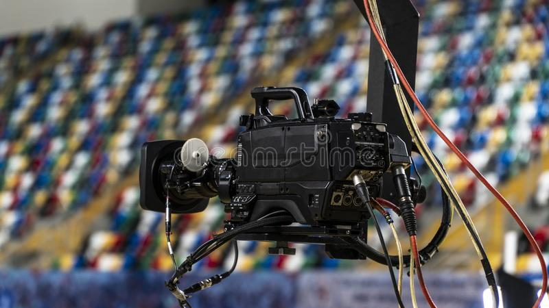 A television camera on a crane outside the studio. The video camera hanging on the crane prepares royalty free stock photo