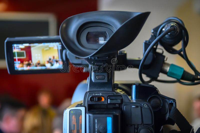 Television Camera Recording News Conference. Spokespersons At The Desk. Journalists Covering A Press Event.  royalty free stock photography