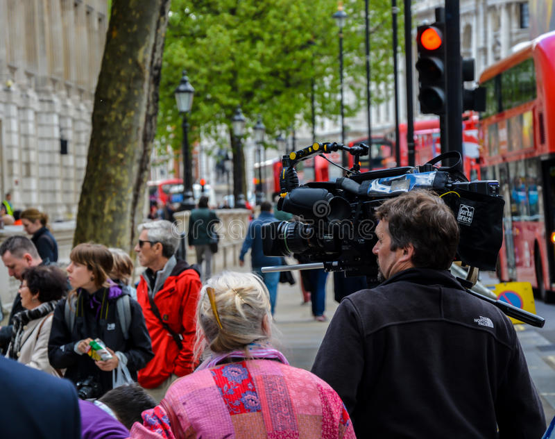 Television Cameraman London. A picture taken of a television cameraman reporting on the general elections outside the gates of 10 Downing street London, the stock photo