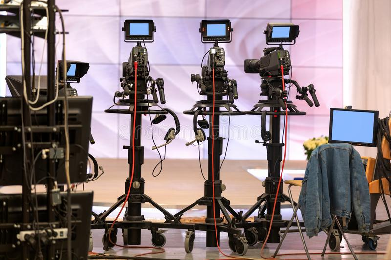 Television cameras during the break. Television cameras in a television Studio during a break stock photos