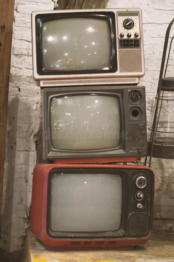 Television. Older televisions that do not work, then posed stacked stock images