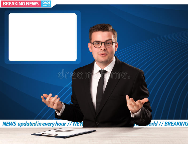 Television reporter telling breaking news at his studio desk wit. H copy space concept royalty free stock photo