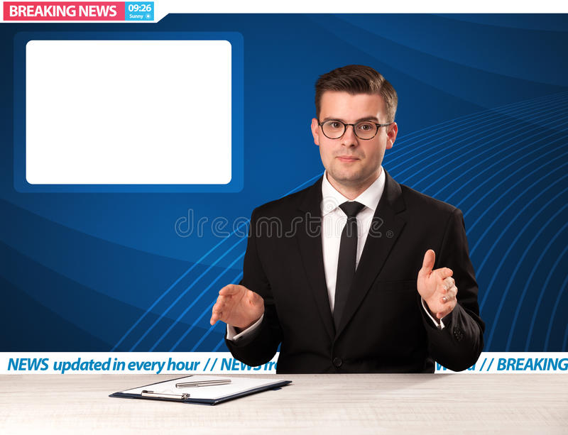 Television reporter telling breaking news at his studio desk wit. H copy space concept royalty free stock photography