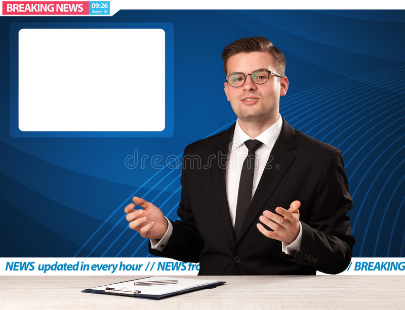 Television reporter telling breaking news at his studio desk wit. H copy space concept royalty free stock images