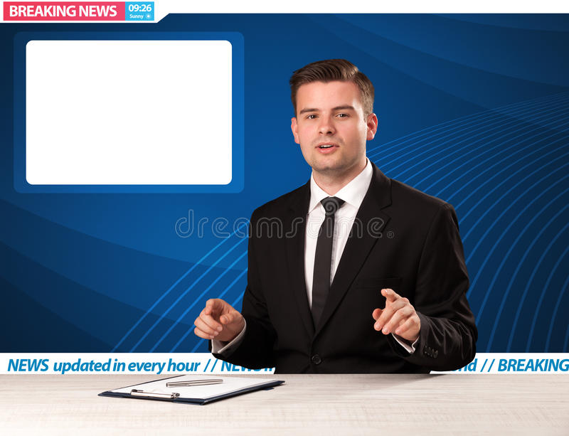 Television reporter telling breaking news at his studio desk wit. H copy space concept stock photography