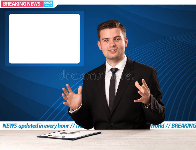 Television reporter telling breaking news at his studio desk wit stock photography