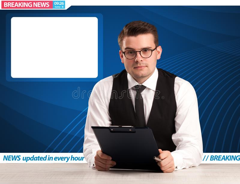 Television reporter telling breaking news at his studio desk wit. H copy space concept stock image