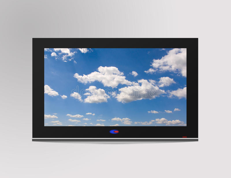 Television set. Modern flat television set with cloudscape on screen, over a gray wall stock photos