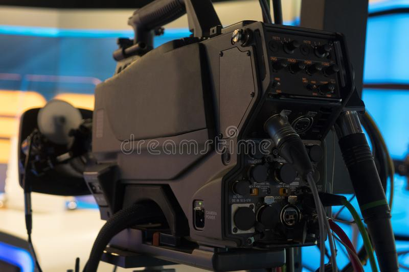 Television studio with camera and lights - recording TV show. Shallow depth of field stock image